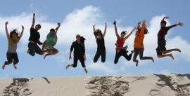 CroppedImage270137-4e7be3c02317d_920_group-jumping-at-henty-dunes-on-tasmanian-west-coast